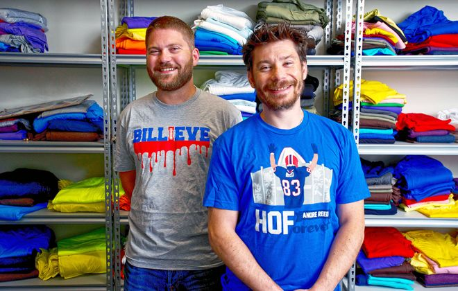 Del Reid, left, founded 26Shirts to benefit families in need, many who have children battling life-threatening diseases. Dan Gigante, right, produces the t-shirts and helps handle sales. The company does not profit; 100 percent of proceeds (after costs) go to the families.