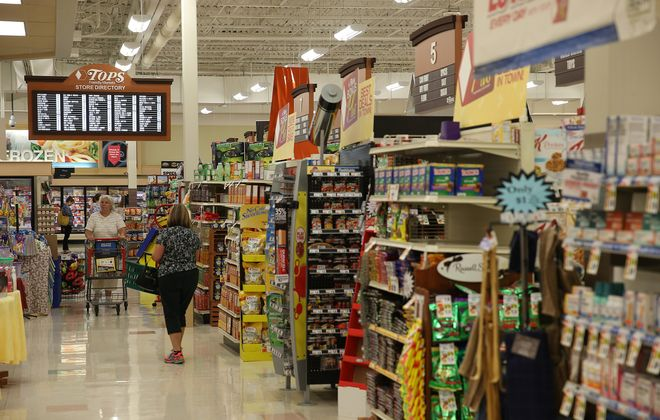 "Tops Markets is set to unveil a ""price lock guarantee"" on Sunday in hopes of improving its competitive edge in an increasingly crowded field of businesses selling groceries. (Charles Lewis/Buffalo News)"