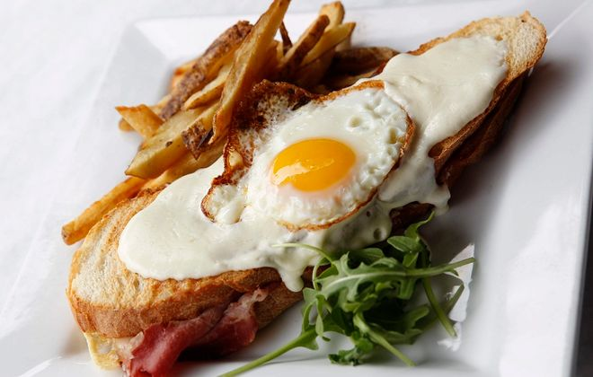 Craving's croque madame sandwich is a grilled cheese with ham on house-made sourdough bread. (Sharon Cantillon/Buffalo News)