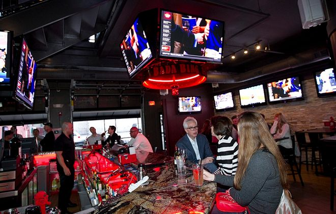 Multiple big-screen televisions fill Bada Bing's new home on Chippewa Street. A grand reopening is set for tonight. (Sharon Cantillon /Buffalo News)
