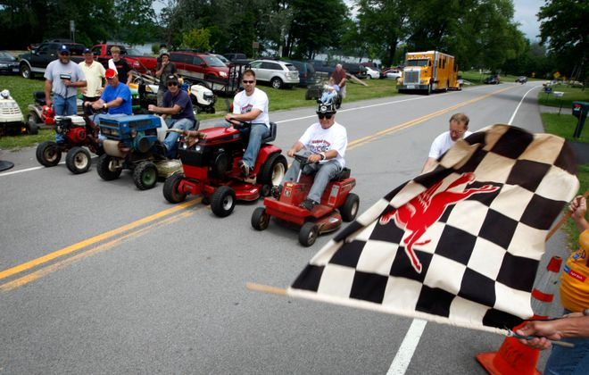 Video: Lawn mowers, racing combine for Father's Day tradition on Grand Island