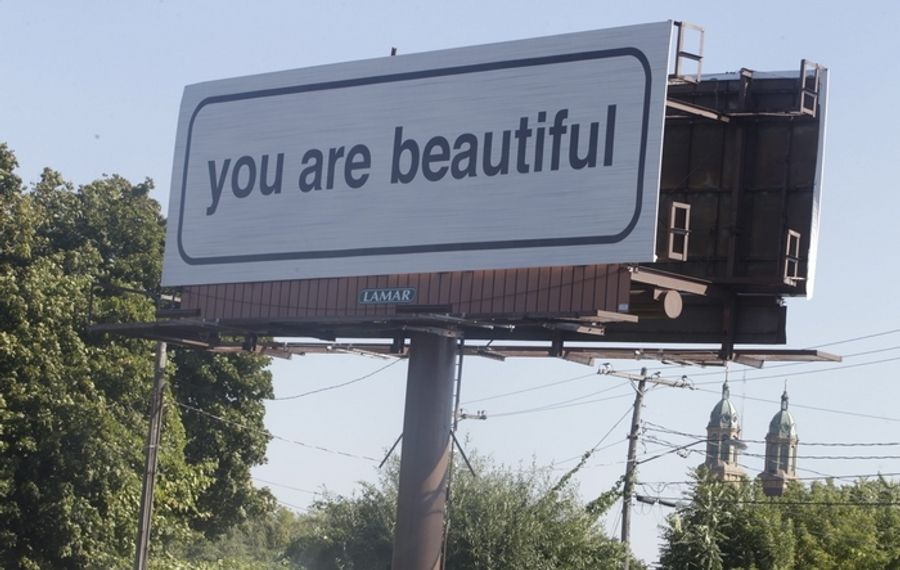 This billboard visible from Grant Street near the Scajaquada Expressway is part of the Albright-Knox Art Gallery's public art program. Sponsored by Lamar Advertising, it eventually will feature the phrase on 44 billboards. (John Hickey/Buffalo News)