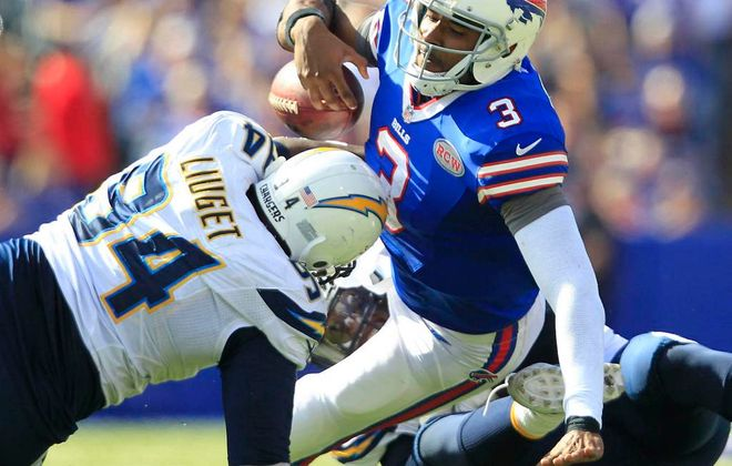 EJ Manuel nearly fumbles the ball after being sacked in the second half.  (Harry Scull Jr./Buffalo News)
