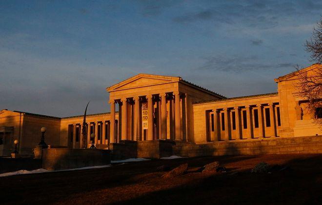 Intense morning light paints the Albright Knox Art Gallery as the sun rises.  (Derek Gee/Buffalo News)