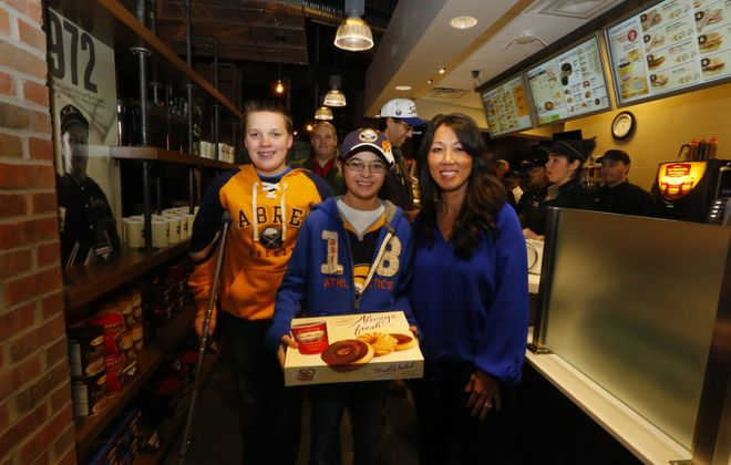 Michael Stranz and Jackson DiCarlo, both 13, with Kim Pegula at the opening of HarborCenter's one of a kind Tim Hortons Cafe and Bakeshop today.(John Hickey/Buffalo News)