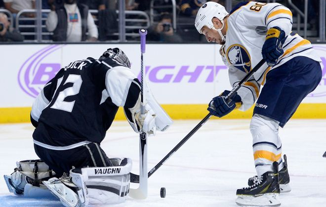 Chris Stewart of the Sabres is stopped by Kings goaltender Jonathan Quick during the first period at Staples Center on Thursday night.