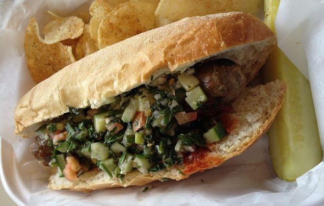 The Curry Lamb Bam, $8, includes a lamb-shank sausage, harissa, raita and tabouleh. (Ben Tsujimoto / Special to the News)