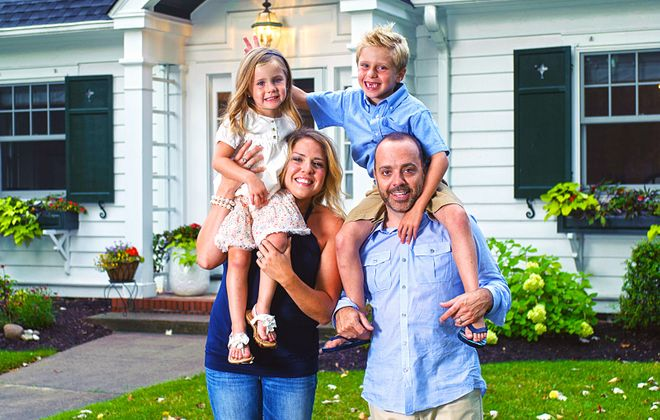 """Jessica and Bill Moore of Snyder, who juggle demanding careers with parenthood, have learned to say """"no"""" to too many scheduled activities for their two children.  (Michael P. Majewski)"""