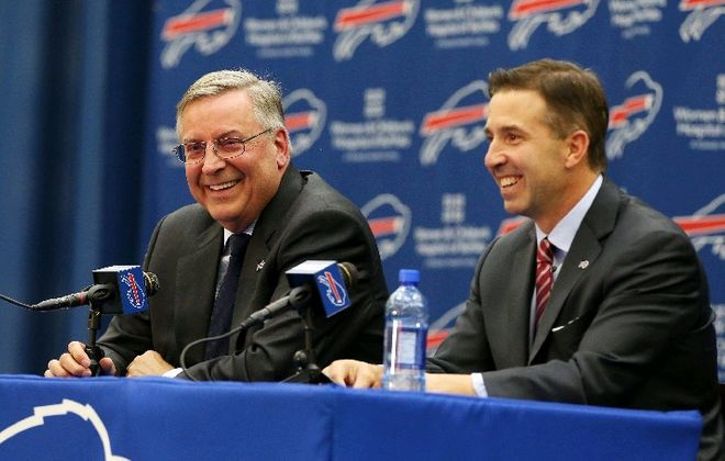Terry Pegula (left) and Russ Brandon during today's news conference. (James P. McCoy/Buffalo News)