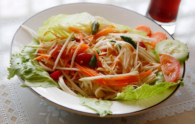 The green papaya salad with cherry tomatoes, green beans and roasted peanuts in lime juice from Yummy Thai in Kenmore. (Sharon Cantillon/Buffalo News)