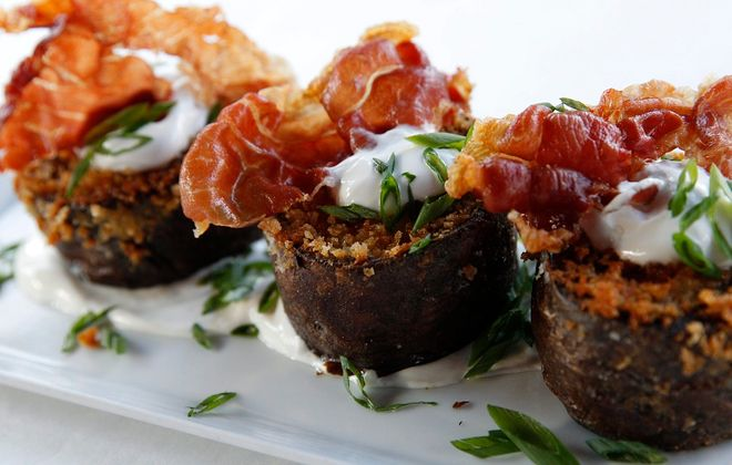 The potato skins small plate at Bacchus features Gorgonzola, green onion and crispy prosciutto. (Sharon Cantillon/Buffalo News file photo)