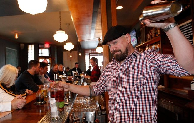 Ballyhoo owner Timothy Stevens shakes up one of his specialty drinks called Jam Sessions.