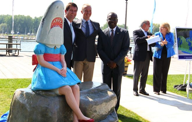 To build off the success of Shark Girl, local cultural organizations hope for more county funding this year. Pictured from left are Erie County Executive Mark Poloncarz, Albright-Knox director Janne Siren and Buffalo mayor Byron Brown. (Mark Mulville/Buffalo News file photo)