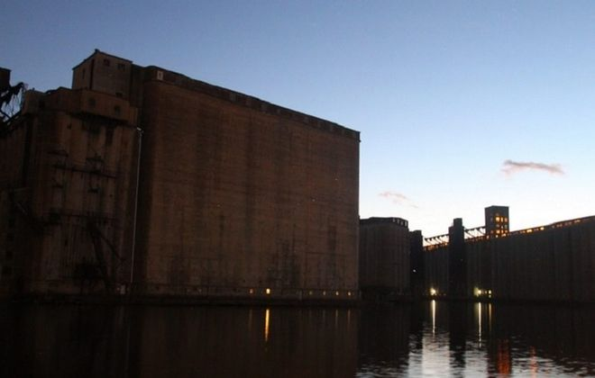 The grain elevators loom over the Buffalo River, the site of historic tours offered by the Valley Community Association of the Old First Ward. (John Hickey/Buffalo News file photo)