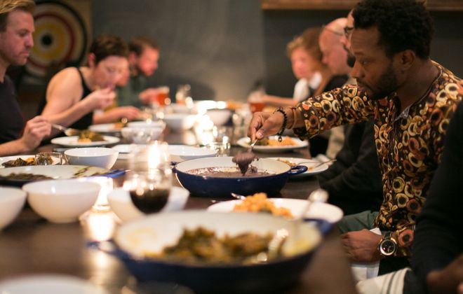 Diners sample Tunde Wey's Nigerian menu at Chicago's Ampersand earlier this month.