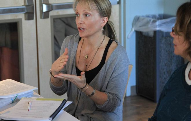University at Buffalo Associate Professor Catherine Cook-Cottone worked to help start free yoga classes in the Resurrection Church Community Room. (Courtesy of Kripalu Center for Yoga & Health)