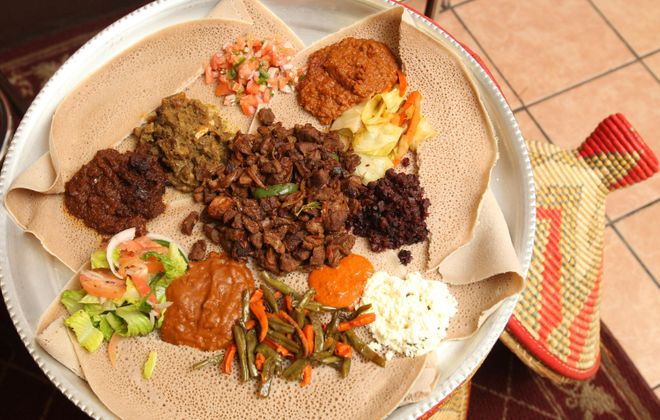 A sampler of Lucy Ethiopian's meat and vegetarian offerings, on injera bread.