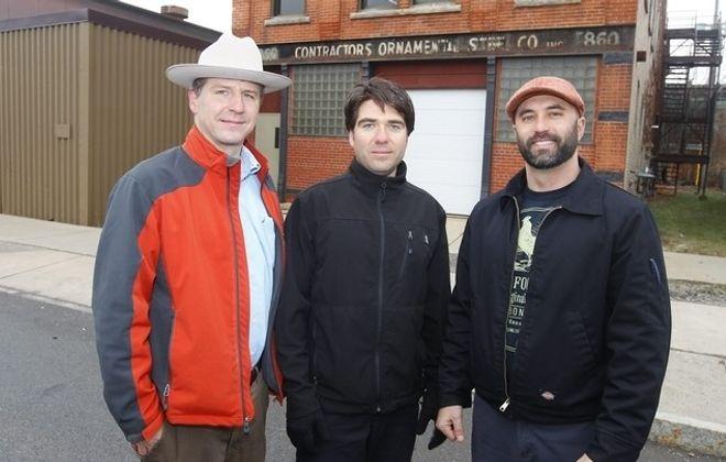 Owners Andy Wegrzyn, left, Eric Kempisty and Frank Weber stand outside Buffalo Distilling Co. on Seneca Street Wednesday. (John Hickey/Buffalo News)