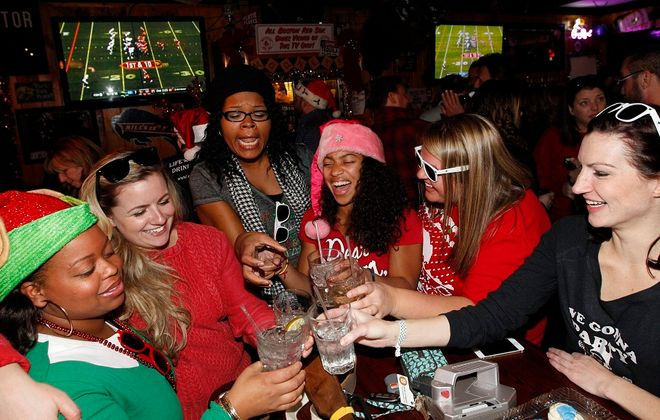 At Mooney's Sports Bar and Grill in Kenmore, a group of friends celebrate the season and a birthday. From left are Shivone Wright, Ashley Rizzo,  Danielle Lopez, Ashley Stewart, Justine Smith and birthday girl Cheryl Ermer. For more photos, see a gallery at  www.buffalonews.com. (Sharon Cantillon/Buffalo News)