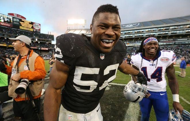 Raiders linebacker Khalil Mack has a laugh with Bills receiver Sammy Watkins  after Sunday's game. (James P. McCoy/Buffalo News)