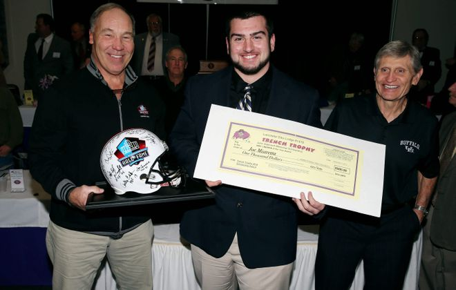 James P. McCoy/Buffalo NewsJamestown's Joe Mistretta is presented the Trench Trophy by former Bills offensive lineman Joe DeLamielleure, left, and longtime offensive line coach Jim McNally.