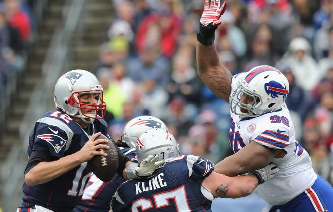 Tom Brady is tackled by Stefan Charles during the second quarter. (Getty Images)