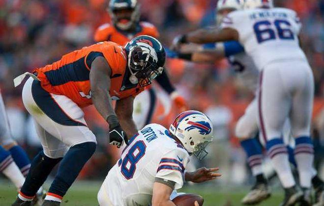 Broncos defensive end Malik Jackson sacks Buffalo quarterback Kyle Orton in the second quarter. (Getty Images)