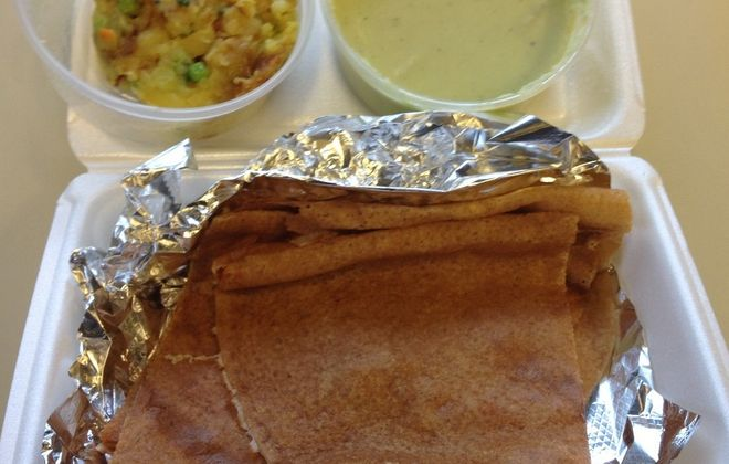 Masala dosa with spiced potatoes and coconut chutney, take-out from Chennai Express.