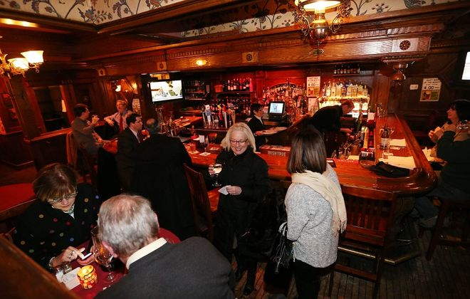 Patrons hang out at the bar at the Eagle House in Williamsville.  (Sharon Cantillon/Buffalo News)