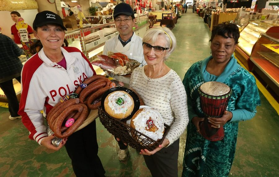 The business owners at the Broadway Market are ready for the Easter season with their specialty products. From left are Michelle Lupas Rozanski of Lupas Meats, Steve Lee of Broadway Seafood, Hanna Robieniek of Chrusciki Bakery and Eva Jeter of Everything African and More. (Sharon Cantillon/Buffalo News)