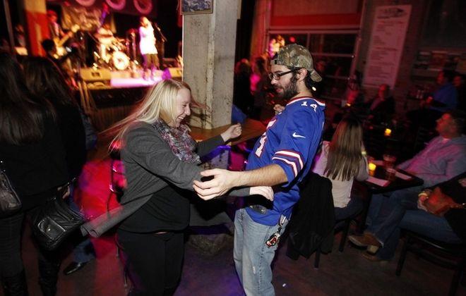 Miranda John and Scott Scheffler dance to live music at Buffalo Iron Works. (Sharon Cantillon/Buffalo News)