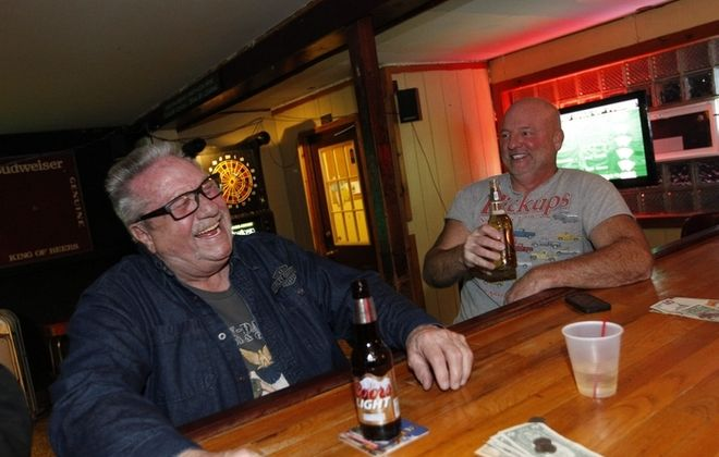 Paul Rhonemus, left, of Riverside and Jim Kehoe of Grand Island have some laughs in San-Dee's Pub. For more photos, see a gallery at www.buffalonews.com. (Sharon Cantillon/Buffalo News)