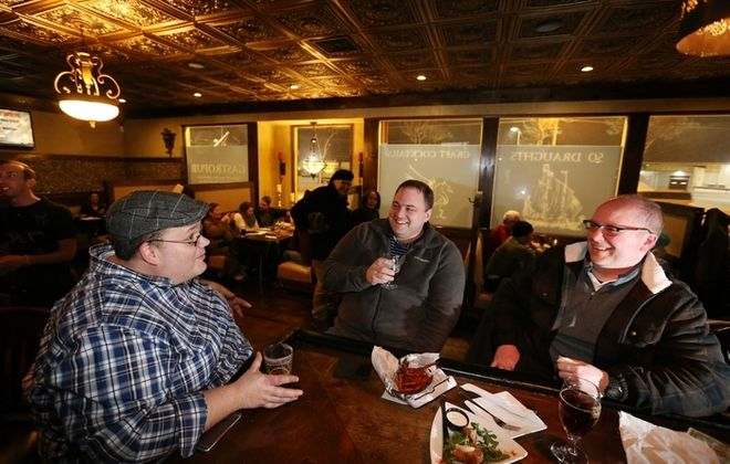 Kevin Wise, left, of Cheektowaga, Ryan Allen of the Town of Niagara and Darren Carson of the Town of Tonawanda enjoy beer and snacks. More photos at www.buffalonews.com. (Photos by Sharon Cantillon/Buffalo News)