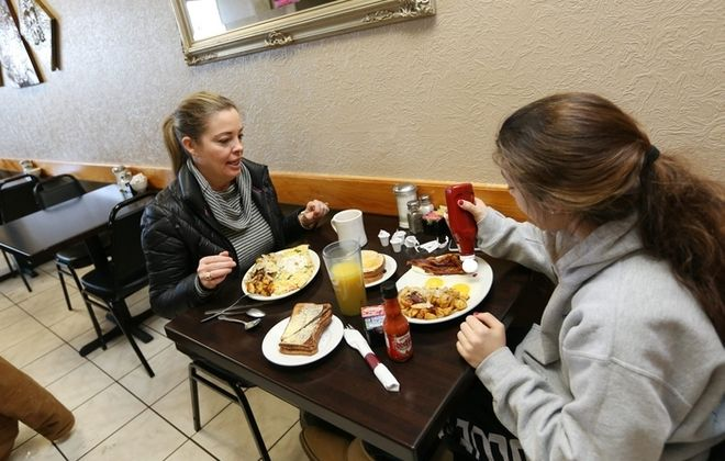 Lisa Chimera, left, and her daughter Allie have breakfast at Greek on the Street on Delaware Avenue in Kenmore. (Sharon Cantillon/Buffalo News)
