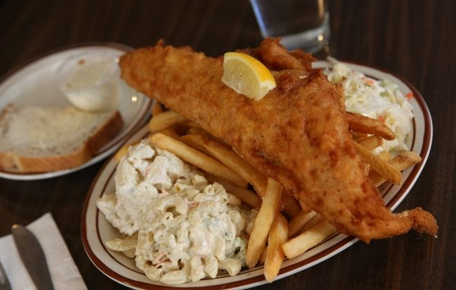 Wiechec's on Clinton Street is a popular place for a fish fry. The beer batter fish fry comes with macaroni and potato salads, french fries, coleslaw and rye bread. (Sharon Cantillon/Buffalo News)