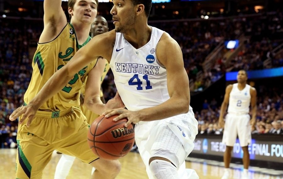 Kentucky's Trey Lyles drives against Notre Dame's Steve Vasturia in the first half of the Midwest Regional Final. (Getty Images)
