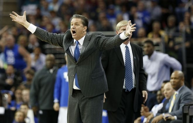 Kentucky head coach John Calipari questions a call in the second half against Notre Dame in the NCAA Tournament's Elite 8 on Saturday, March 28, 2015, at Quicken Loans Arena in Cleveland. Kentucky advanced, 68-66. (Charles Bertram/Lexington Herald-Leader/TNS)
