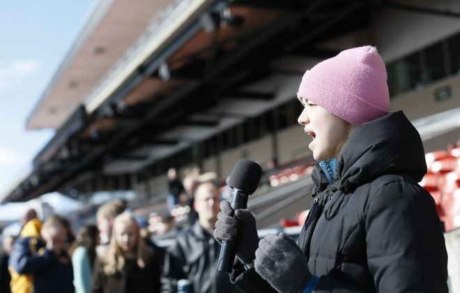 Wearing a knit hat and puffy coat, Jordan Preston, 14, of Amherst, auditions to sing the national anthem before a Bisons game this season during open auditions at Coca-Cola Field on March 28.  (Derek Gee/Buffalo News)