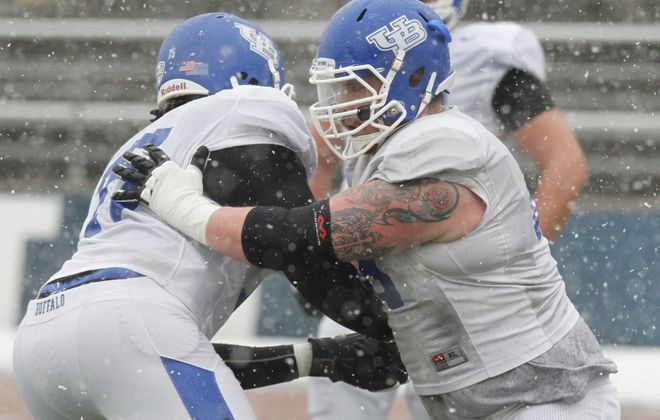 Fifth-year senior Dillon Guy (65) sat out last season due to foot injuries and returned 30 pounds lighter but stronger.