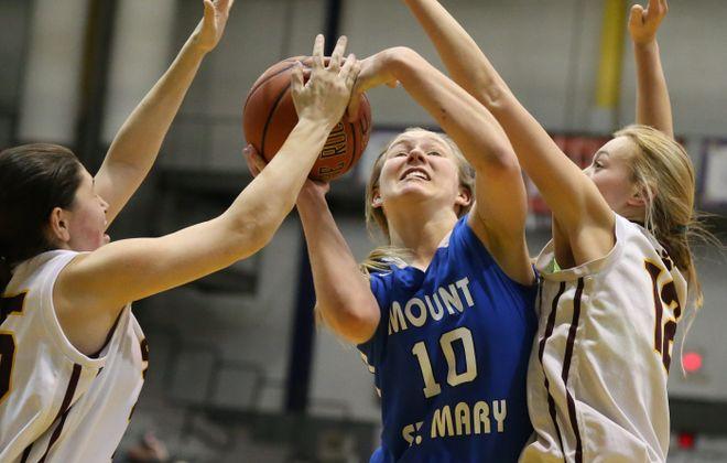 Julie Fleming of Mount St. Mary battles against Staten Island Academy's Sam Spadaro, left, and Corinn Baggs.