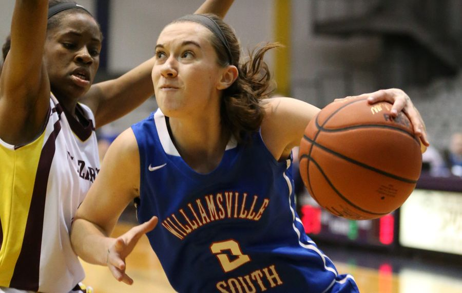 Williamsville South's Erin Egan drives to the basket on Nazareth's Brittney Johnson during the first half  in Albany.