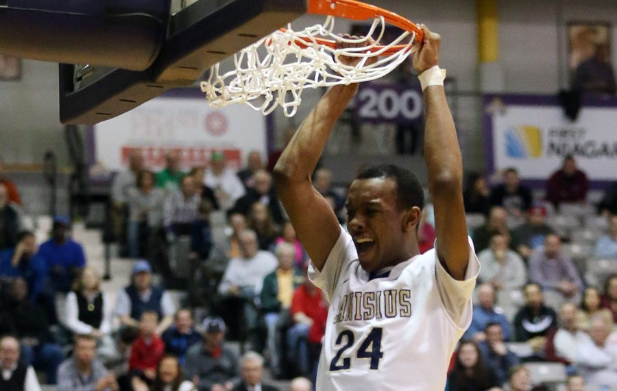 Canisius' Stafford Trueheart dunks two points over Scotia-Glenville's Diamond Corker. (James P. McCoy/Buffalo News)