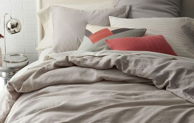 All-linen bedding, such as the Belgian collection from West Elm, westelm.com, is a trend you may want to try. The sculptural flowers, left, are from West Elm as well.