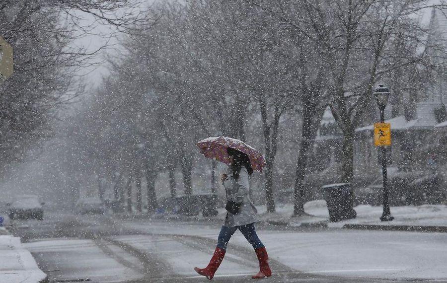 Spring showers look a lot like winter in  Buffalo. Photo by Derek Gee/Buffalo News
