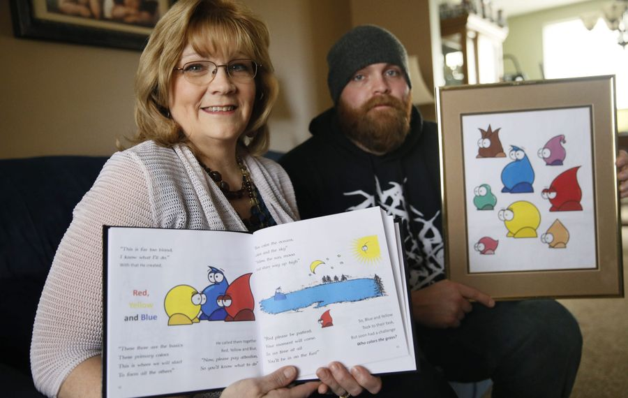 "Paula Banks Dahlke, author of ""The Perfect Color,"" and son Matthew Banks Greenwald, one of her two collaborators, display a sampling of what readers can expect from the book. Also contributing to the effort was her mother, Grace Bechtel Banks, 87."