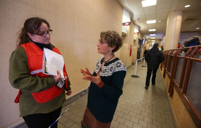 Erie County Health Department staff member Kelly J. Asher, left, hears from Health Commissioner Dr. Gale R. Burstein at Monday's vaccination clinic in the Buffalo Niagara Convention Center in response to the case of hepatitis A  found in a restaurant server Friday. Another clinic is scheduled for Tuesday.