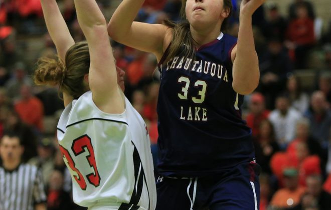 Chautauqua Lake's Jenna Einink shoots over Cooperstown's Mallory Arthurs. Einink scored a game-high 21 points for the Thunderbirds.