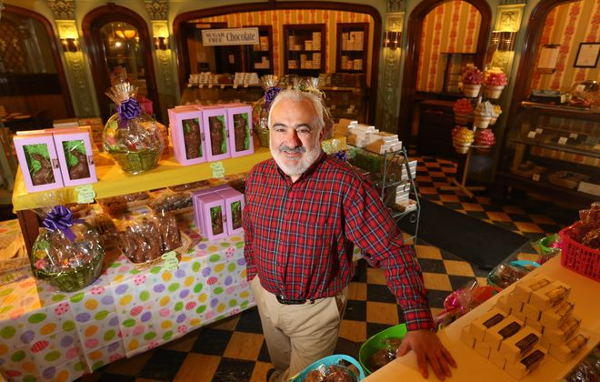 Philip Buffamonte, owner of Parkside Candy, takes a hands-on approach to his business. Each day he supervises the flow of candies coming down the candy line. How does he like his sponge candy? In dark chocolate. He is seen here in his historic confectionery on Main Street.