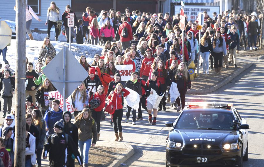 Lancaster students march in protest of the Redskins name change after walking out of school, Thursday, March 19, 2015.  (Derek Gee/Buffalo News)