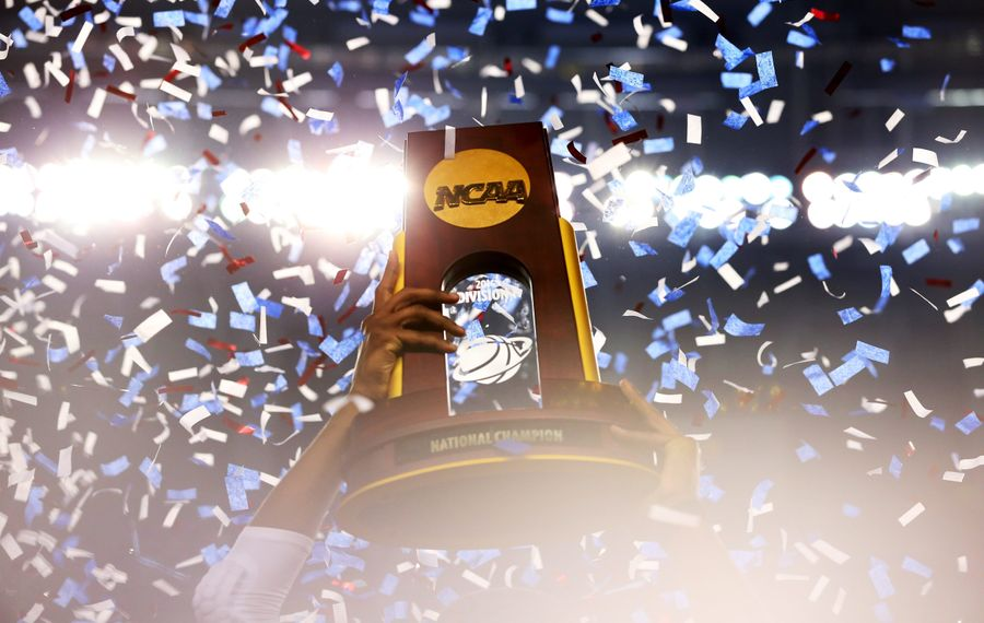 ARLINGTON, TX - APRIL 07:  The Connecticut Huskies celebrate with the trophy after defeating the Kentucky Wildcats 60-54 in the NCAA Men's Final Four Championship at AT&T Stadium on April 7, 2014 in Arlington, Texas.  (Photo by Ronald Martinez/Getty Images)